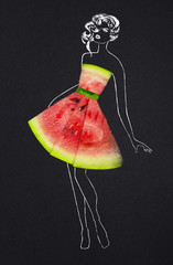 Taste of fashion / Creative concept photo of a watermelon as a dress with illustrated woman on black background.