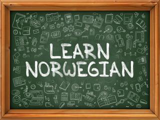 Hand Drawn Learn Norwegian on Green Chalkboard.