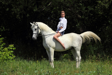 Beautiful young women on horse