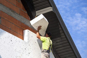 Installation of Styrofoam on the facade of the building