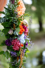 wedding ceremony decorations with colorful flowers