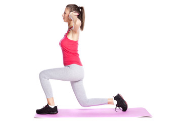 beautiful young woman exercise isolated on white