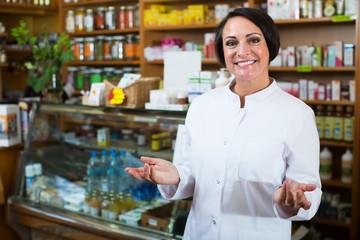Female pharmacist in store