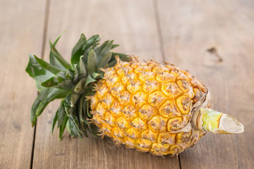 pineapple on the wood  background