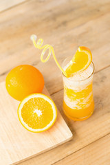 Glass of Orange Smoothie on wooden table