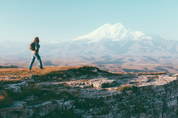 Traveler looking to Elbrus mountain Wall mural