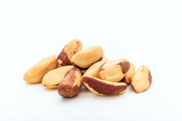 Brazil nuts heap on white background