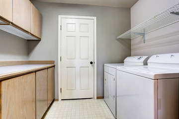 Laundry room with washer and dryer with tile floor.