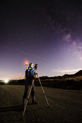 Photographer practicing astrophotography in the night