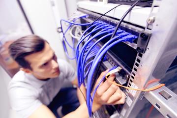 Man in network server room