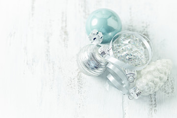Christmas ornaments on a white painted wooden background