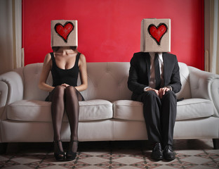 In love man and woman sitting on a couch