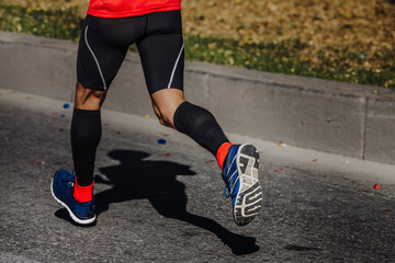Wall Mural - compression socks on feet of a man athlete running a marathon