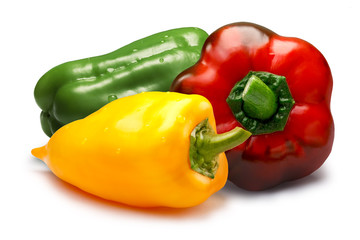 Red, green and yellow sweet bell peppers, paths