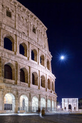 Colosseum and full moon, night view