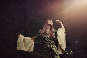 Fairy tale woman in mysterious forest