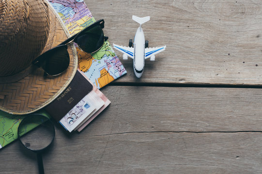 Go on an adventure! The map and the passport on a wooden table.Travel around the world.
