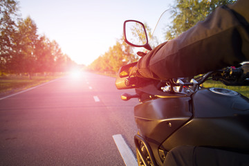 Traveling on a motorcycle.