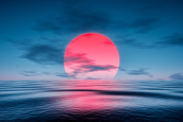 a red sunset over the blue sea