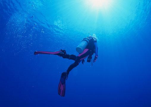 Woman scuba diver under