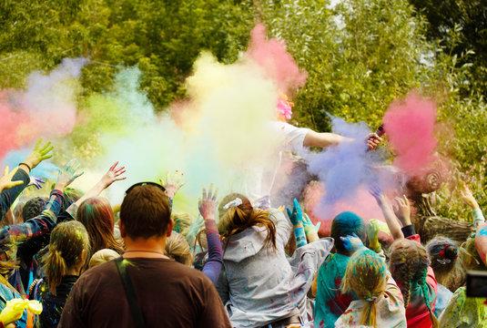 Holi Festival. Children throw colored powder