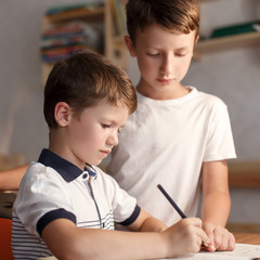 Little boys doing homework at home