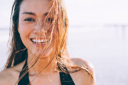 A beautiful girl smile to the sun
