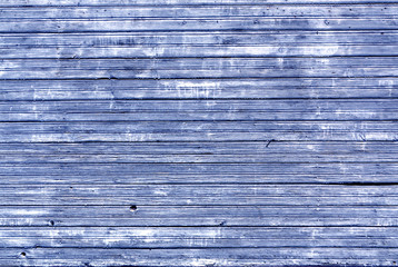 Weathered wooden house wall texture.