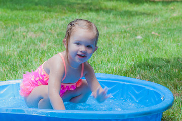 Little Girl Playing in a Kiddie Pool