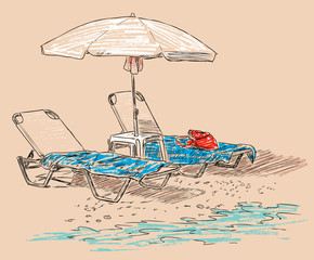 beach umbrella and sunbeds on the seashore