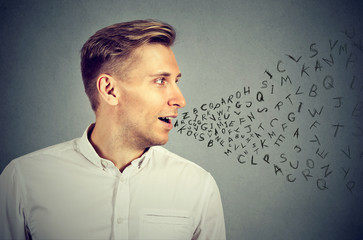 Man talking with alphabet letters coming out of his mouth