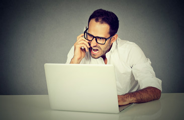 man frustrated and angry shopping online screaming on phone