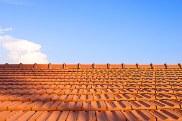 Tile-roofed house on the sky background