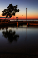 Reflection of the tree and tower in the marina in Poreč, Croatia