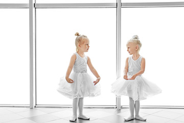 Cute girls practicing ballet in class