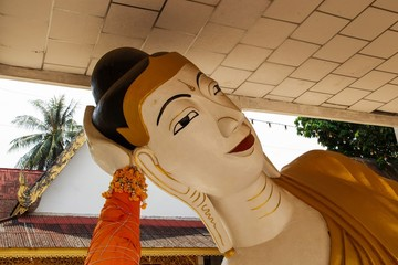 Image of Buddha at the temple in Mae Sot district, Tak province, Thailand. This public place is a landmark of Thailand and allow the tourists can take a photo around.