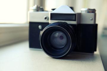 Retro camera on windowsill closeup