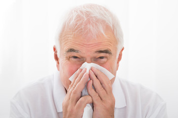 Man Infected With Cold Blowing His Nose