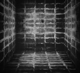 Dark room built from bricks.