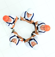 Large group of workers standing in circle top view