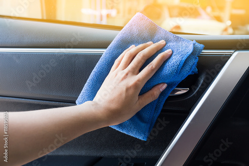 hand with microfiber cloth cleaning interior modern car stock photo and royalty free images. Black Bedroom Furniture Sets. Home Design Ideas