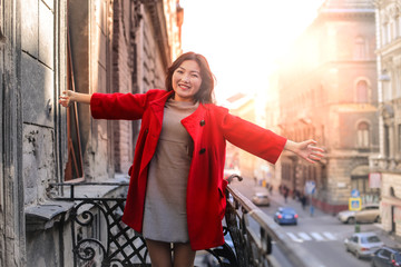 Happy woman in a red coat