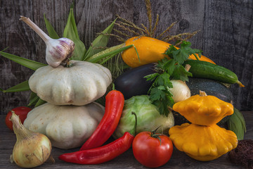 autumn vegetables. a variety of vegetables, lying on dark grey wooden Desk. yellow, white, red and green vegetables. in a rustic style. a lot of vegetables in mounds