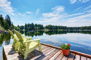 Perfect water view pier. Waterfront lake with small pier. Wall mural
