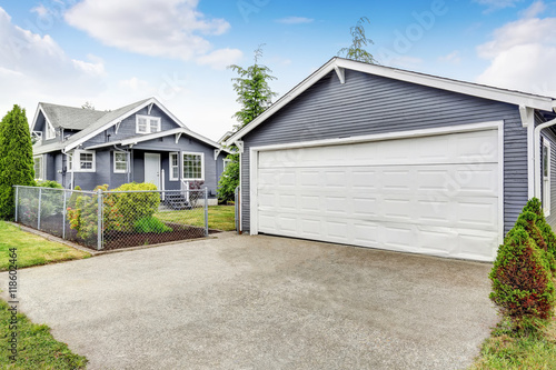 Separate garage with siding trim concrete driveway and for Separate garage
