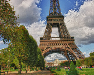 Wall Mural - Clouds over Eiffel Tower in Paris