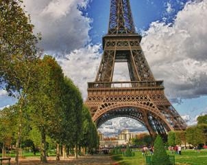 Fototapete - Clouds over Eiffel Tower in Paris