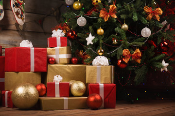Gift boxes and balls under christmas tree