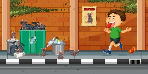 Boy throwing trash on the street