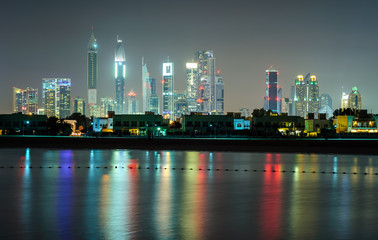 Amazing night dubai downtown skyline with tallest skyscrapers and beautiful Jumeirah beach reflection, Dubai, United Arab Emirates